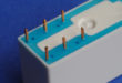 Electronics adhesives cure with UV, visible light or moisture
